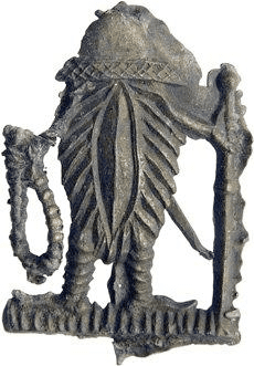 Fig. 7. Vulva figure depicted as a pilgrim with pilgrim's staff and rosary, lead tin, Arnemuiden, the Netherlands, 1425–1475. Family Van Beuningen, Langbroek, Inv.nr. 4462 [cat. HP3, afb. 3026] (photo: Medieval Badges Foundation)
